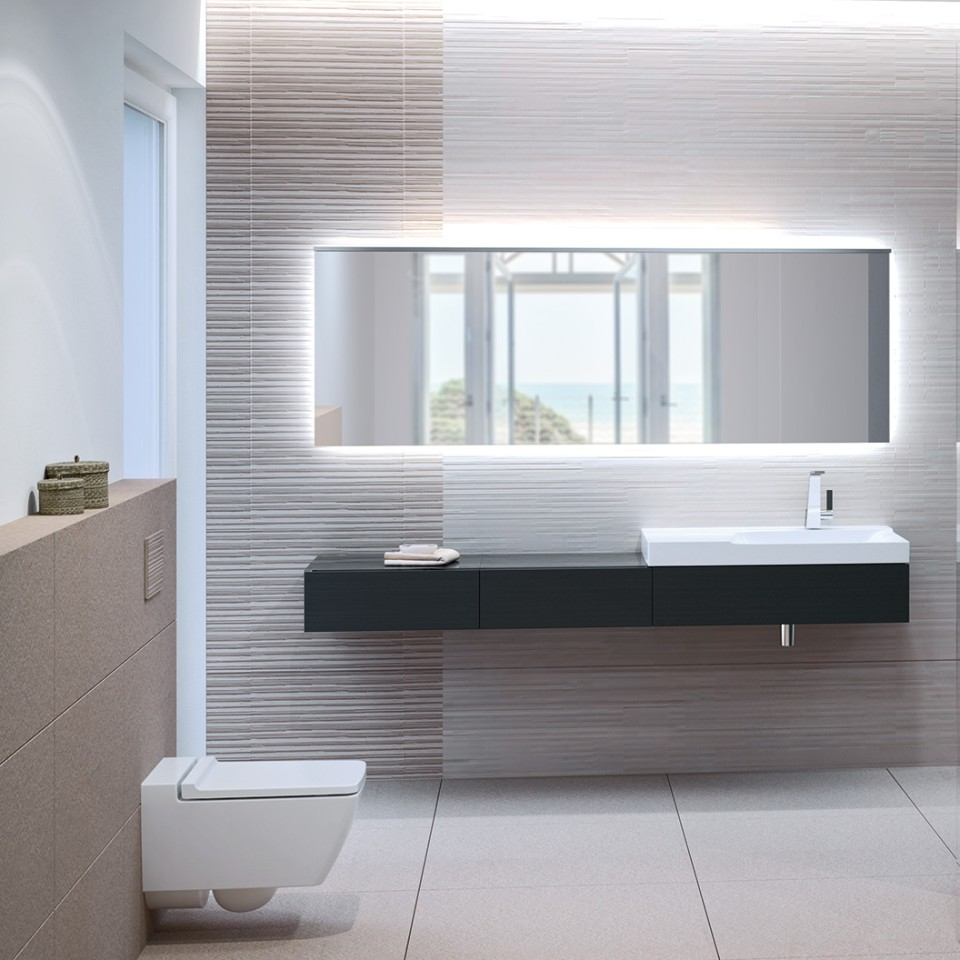 Bathroom with Geberit Xeno² toilet rimfree, actuatorplate Sigma70 and washbasin