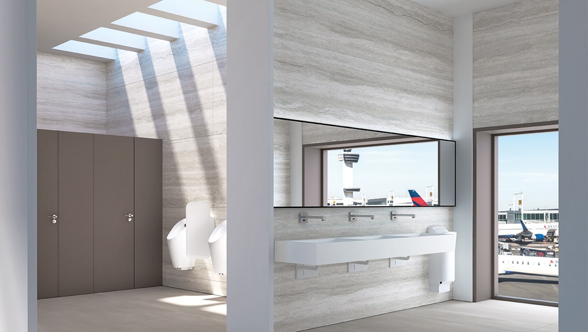 Bathroom equipped with the Geberit Brenta wall mounted tap system in a public area