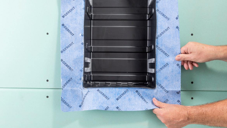 Nischenablagebox mit vormontierter Dichtfolie für die Geberit Duschablage